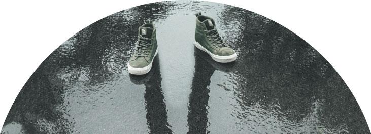 Trainers on rainy pavement